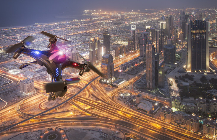 a drone flying over a futuristic city