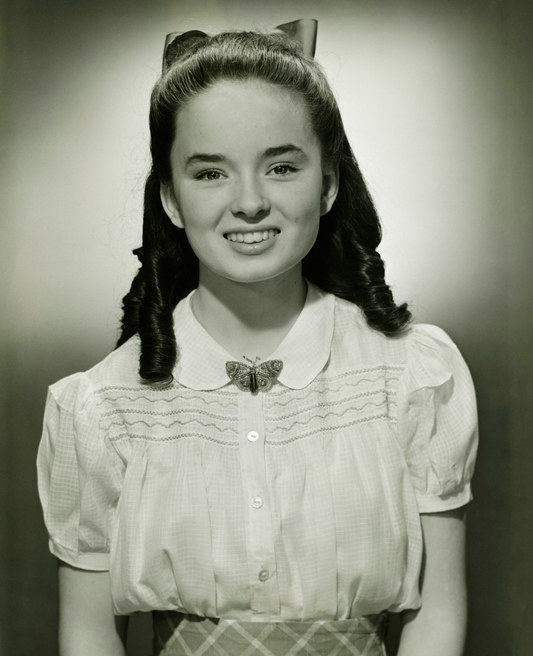 a vintage photo of a young girl