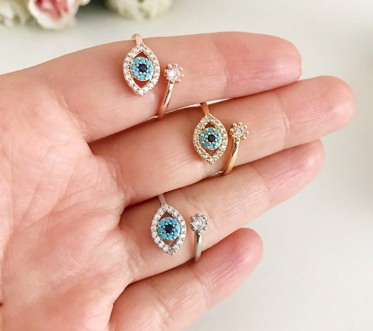 Model wearing three rings