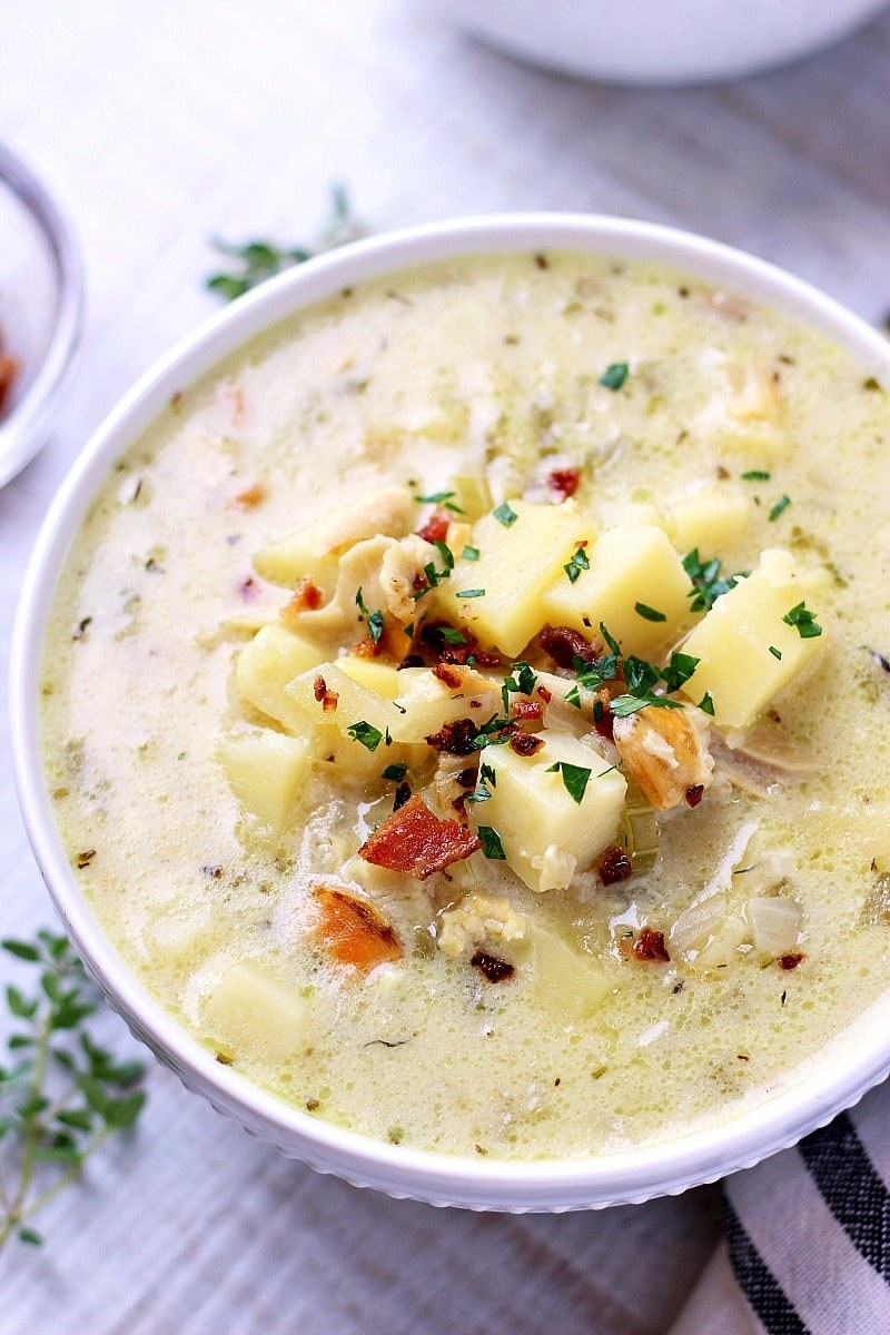 A bowl of thick and creamy New England style clam chowder.