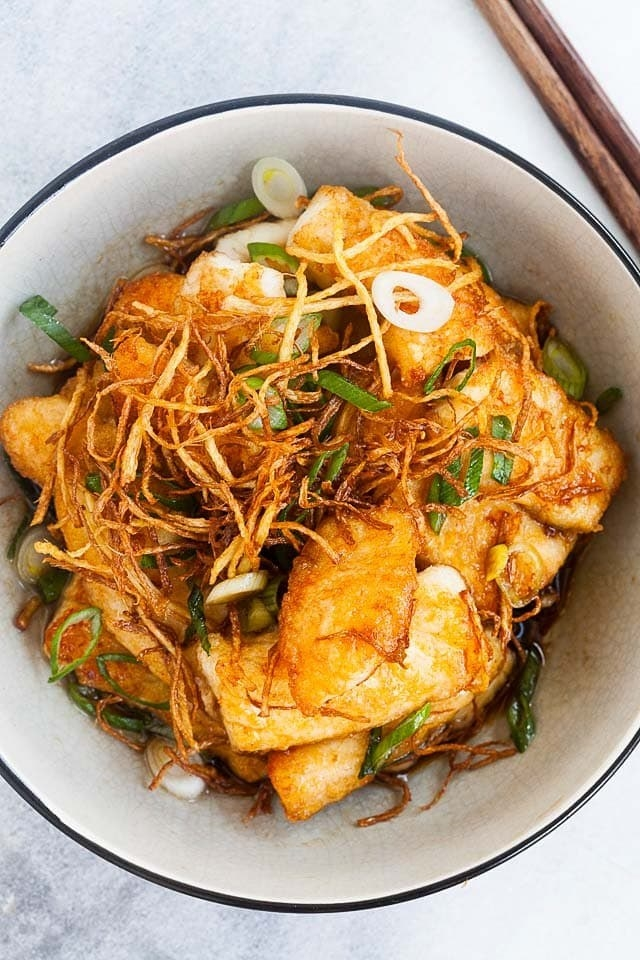 Ginger soy fish with crispy scallions.