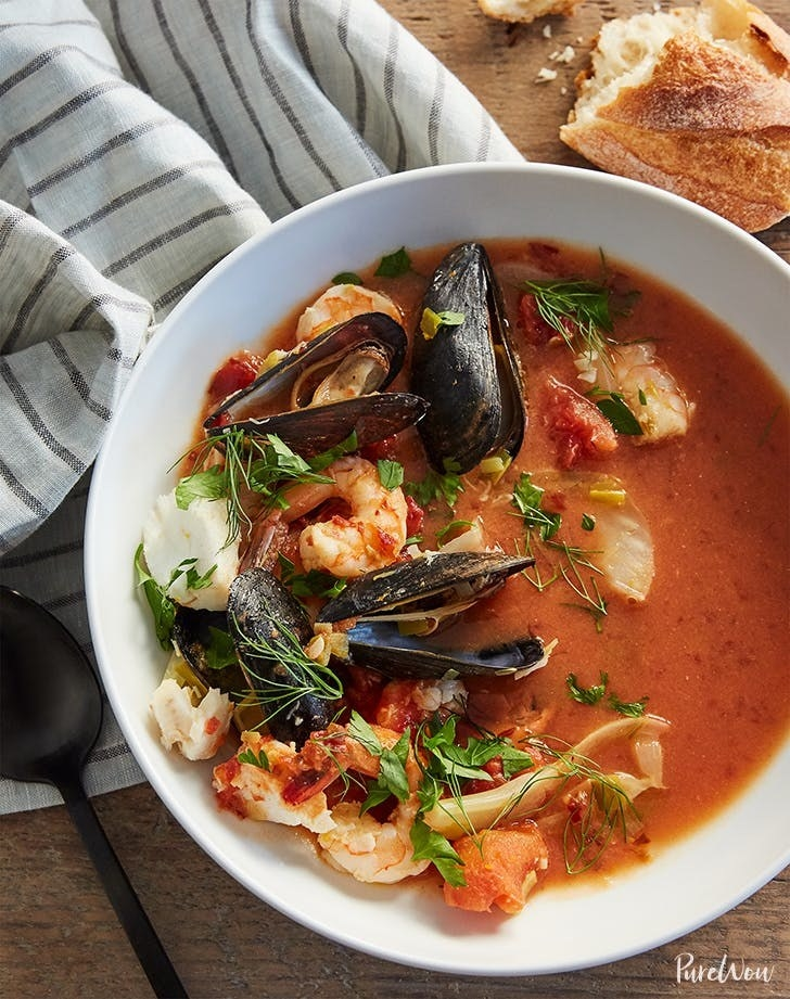 A bowl of cheater's bouillabaisse with shrimp, cod, and mussels.
