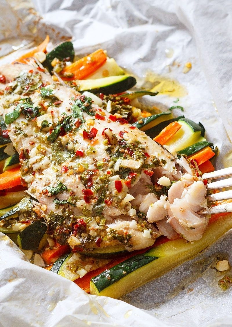Salmon with veggies in parchment paper.
