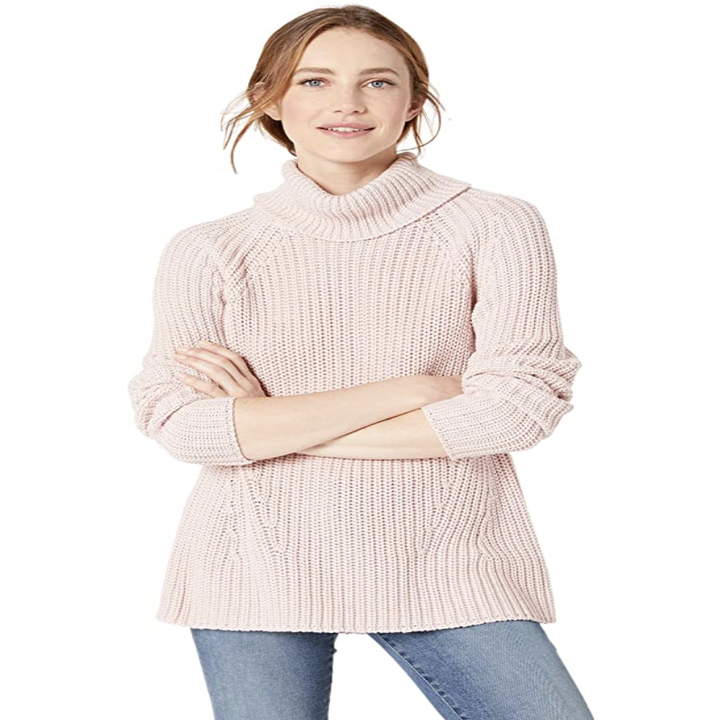 a model in the sweater in light pink