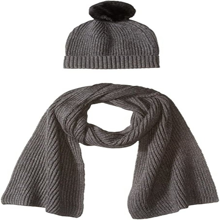 a beanie with a black pom attached and a matching gray scarf
