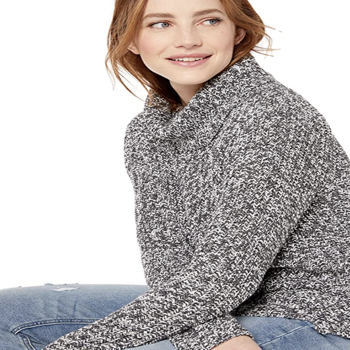 a model in the same sweater in marled gray