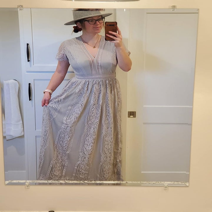 a reviewer in the dress in gray