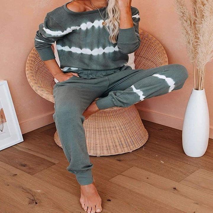 a model in a gray and white tie dye sweatshirt with matching sweatpants