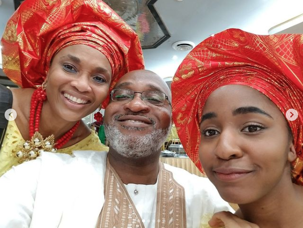 Ayo and her parents in Nigerian apparel