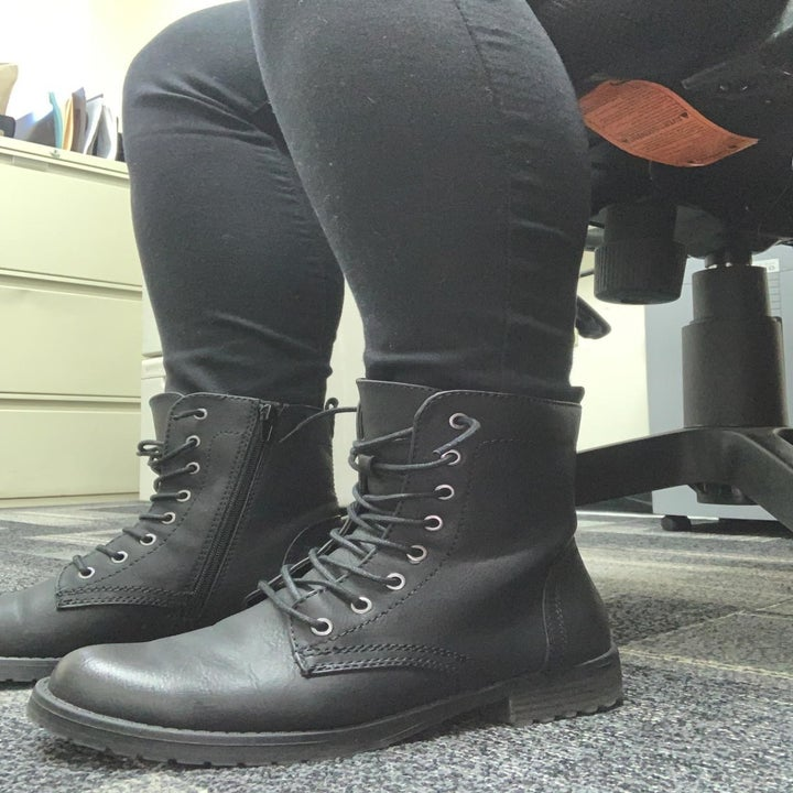 a reviewer wearing the boots in black