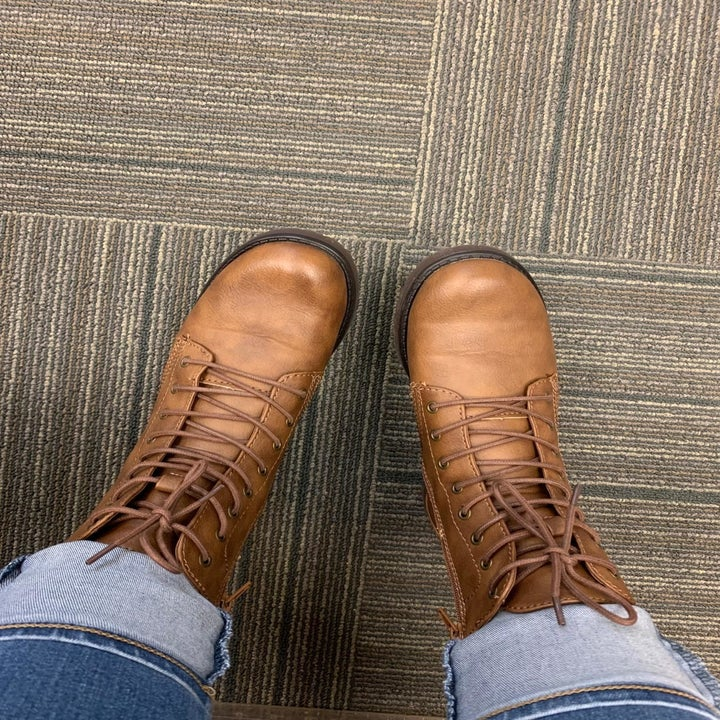 a reviewer wearing the boots in tan