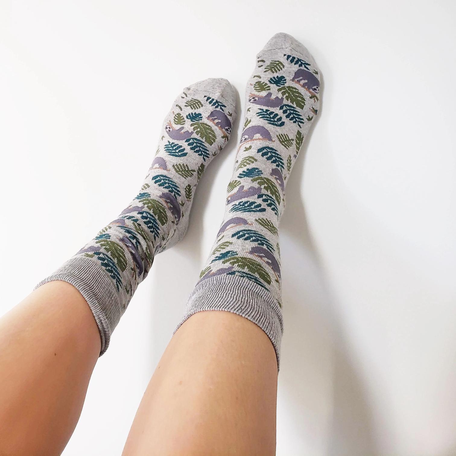 the sloth socks on feet