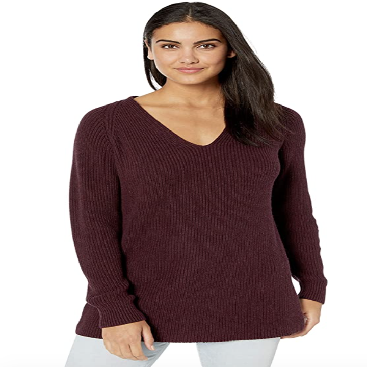 a model wearing the sweater in burgundy