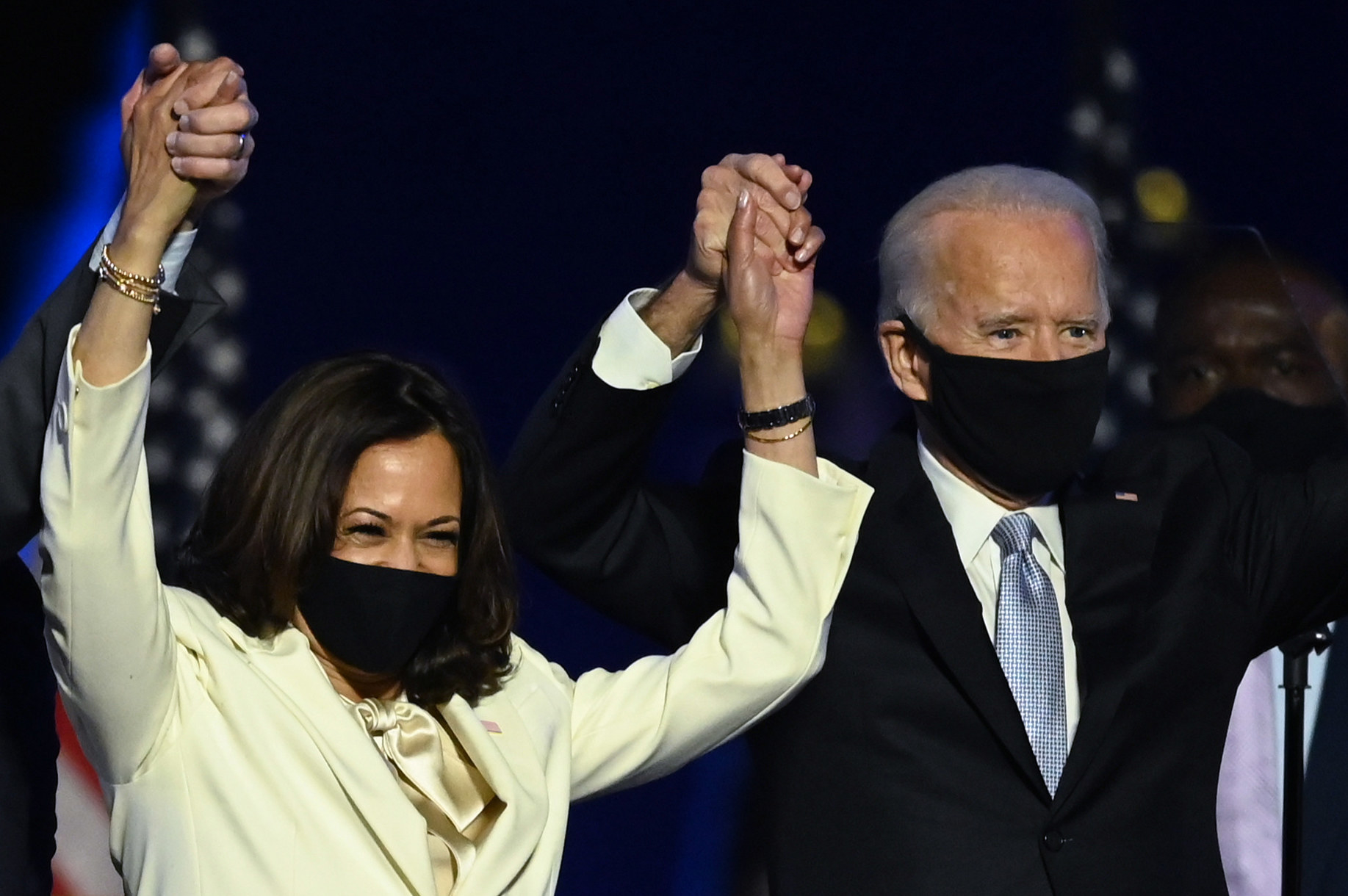 US President-elect Joe Biden and Vice President-elect Kamala Harris stand onstage after delivering remarks after being declared the winners of the presidential election
