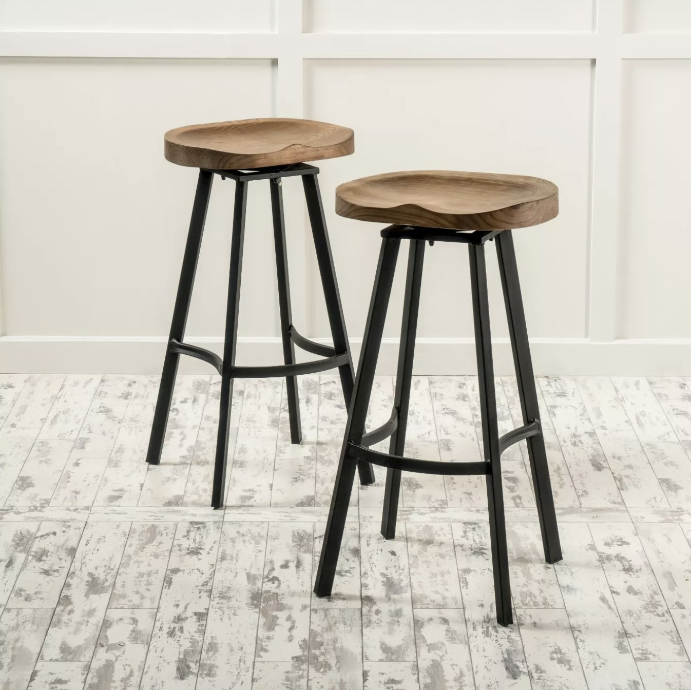 The two wooden bar stools with black legs