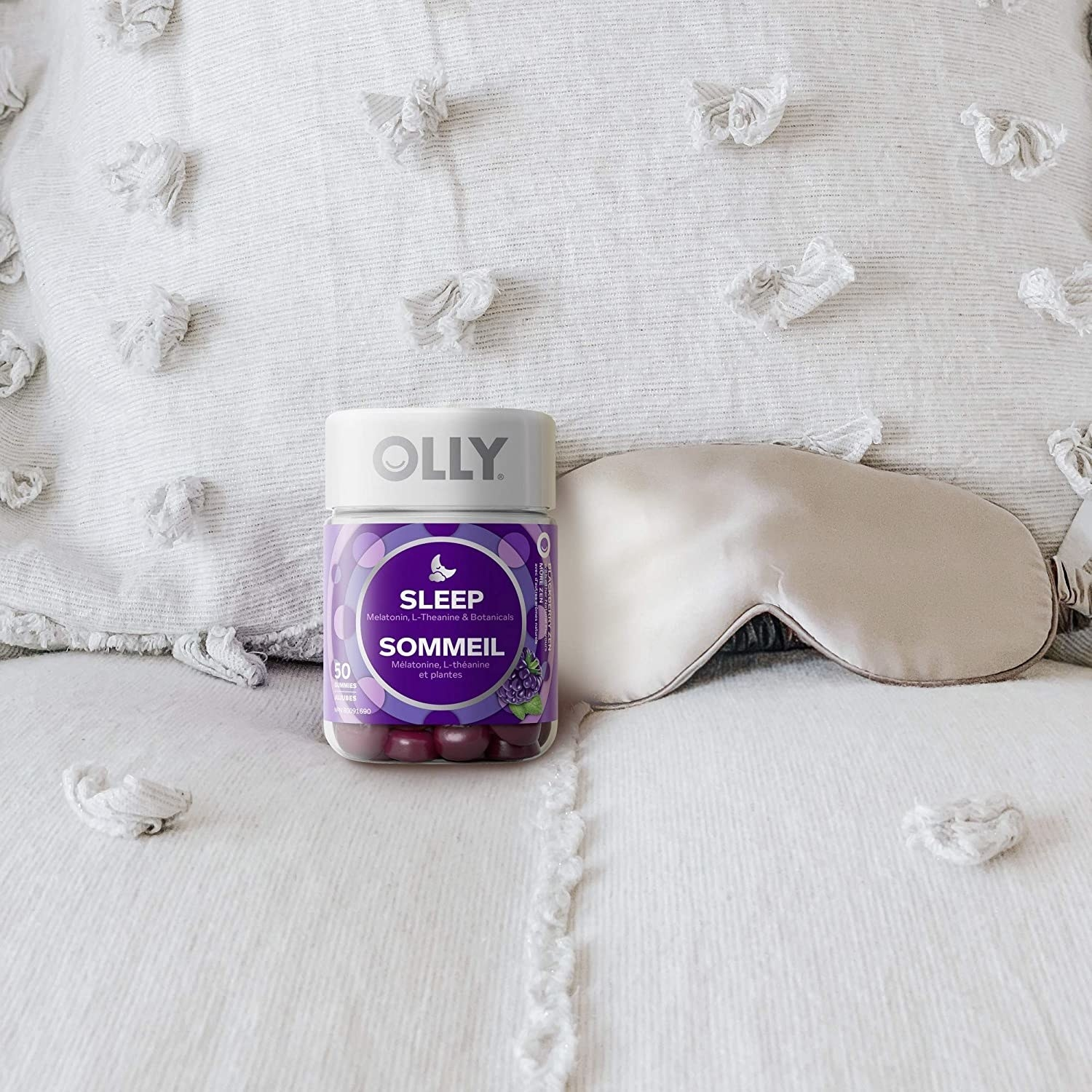 a pack of the vitamins on a bed next to a sleeping mask