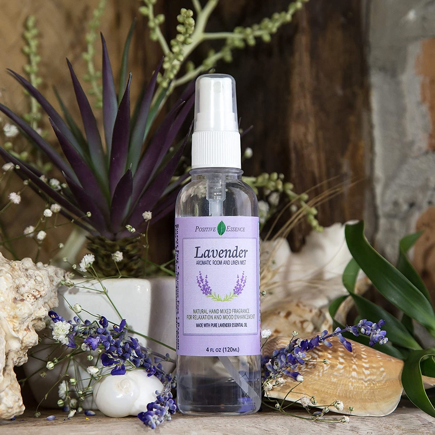 bottle of lavender spray surrounded by lavender flowers