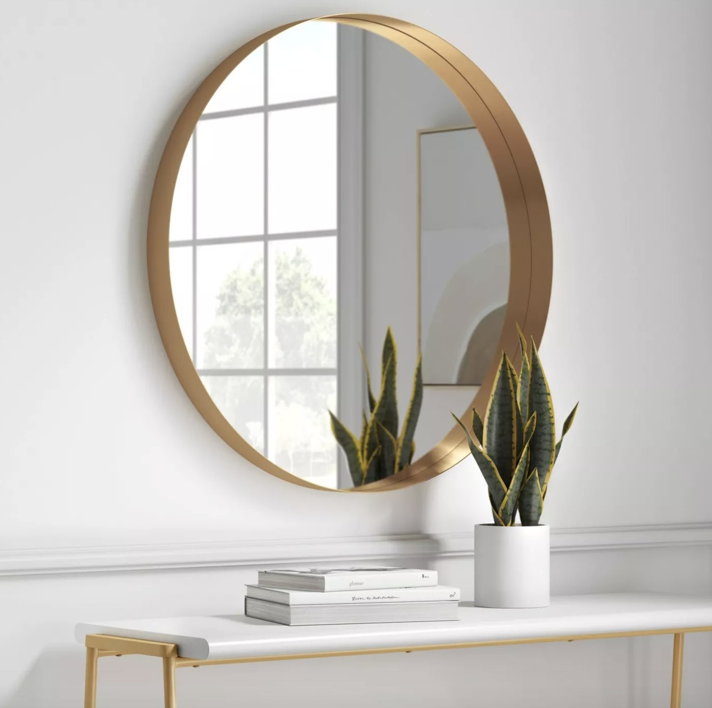 the mirror with gold metal detailing