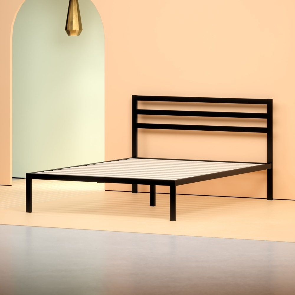 a black metal platform bed with a black metal headboard in a modermn, angular design in a bedroom