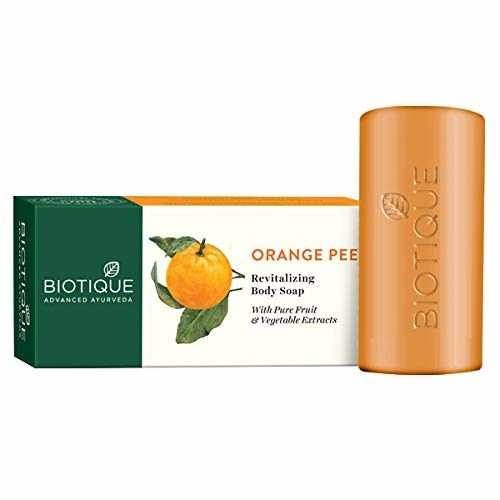 Packaging of the orange peel soap next to the bar of soap