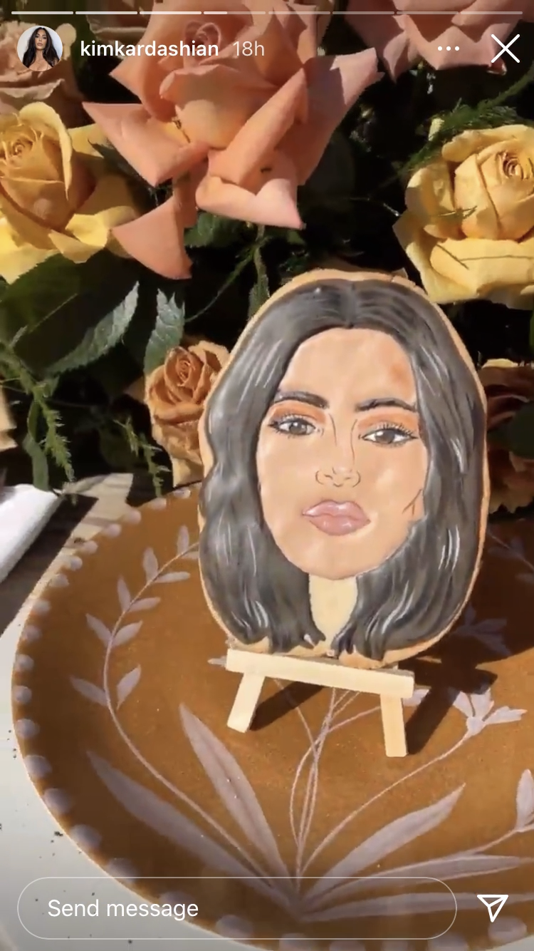 Kim Kardashian Instagram story of a cookie with their faces