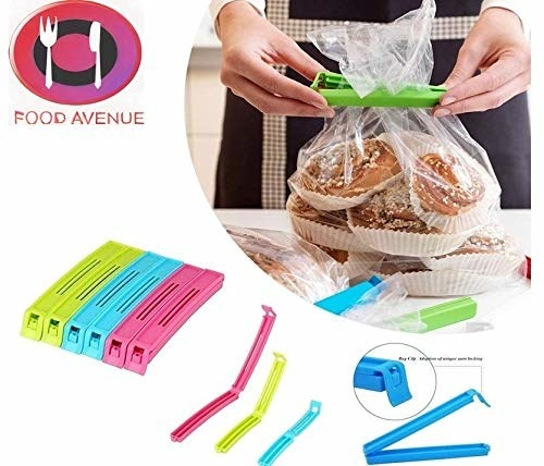A set of bag sealing clips with them being used on a bread