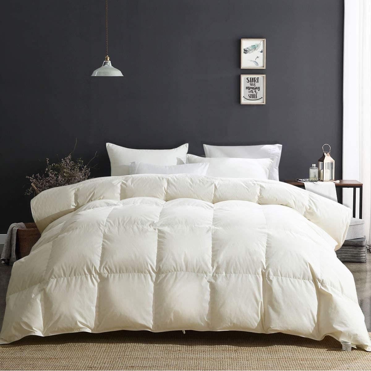 White comforter on mattress in bedroom