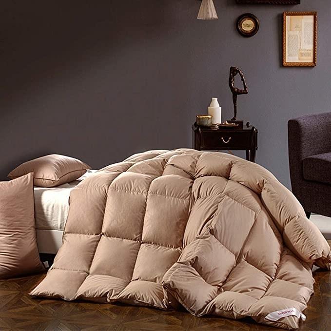 Khaki comforter on mattress in bedroom