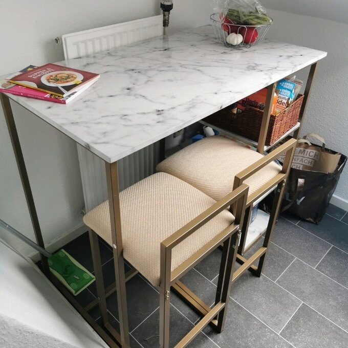 the marble topped table and two chairs