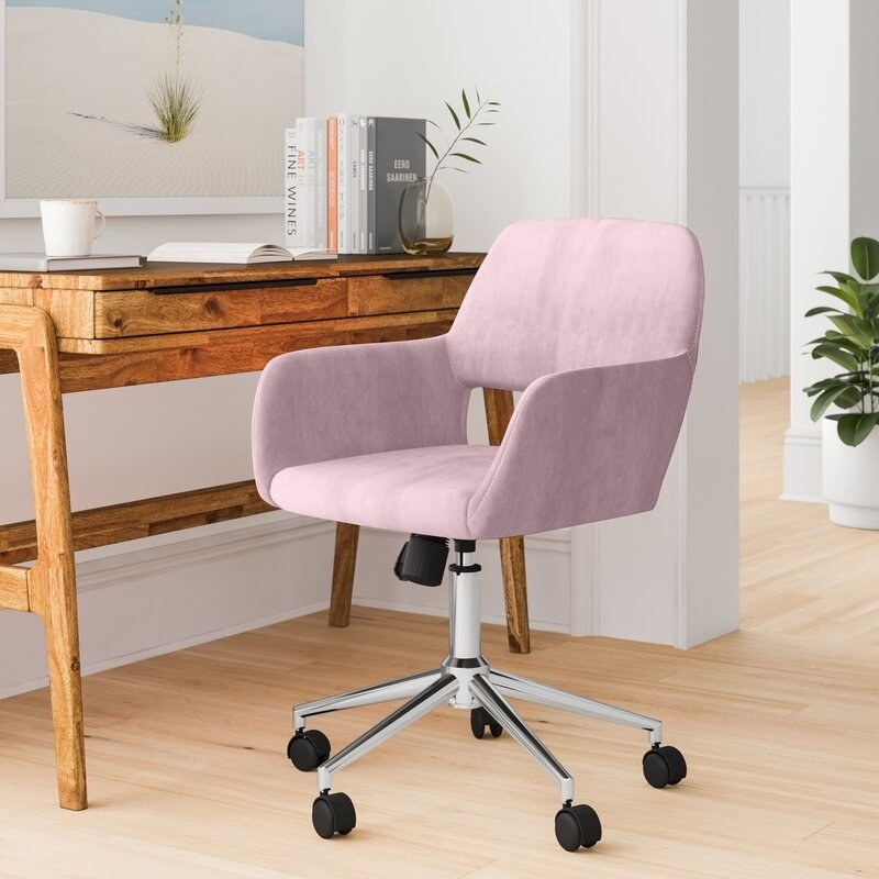 Blush desk chair with chrome frame and black wheels