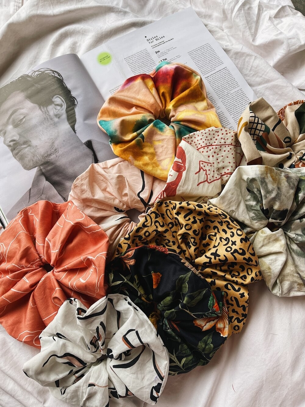 the satin scrunchies in various patterns and colors