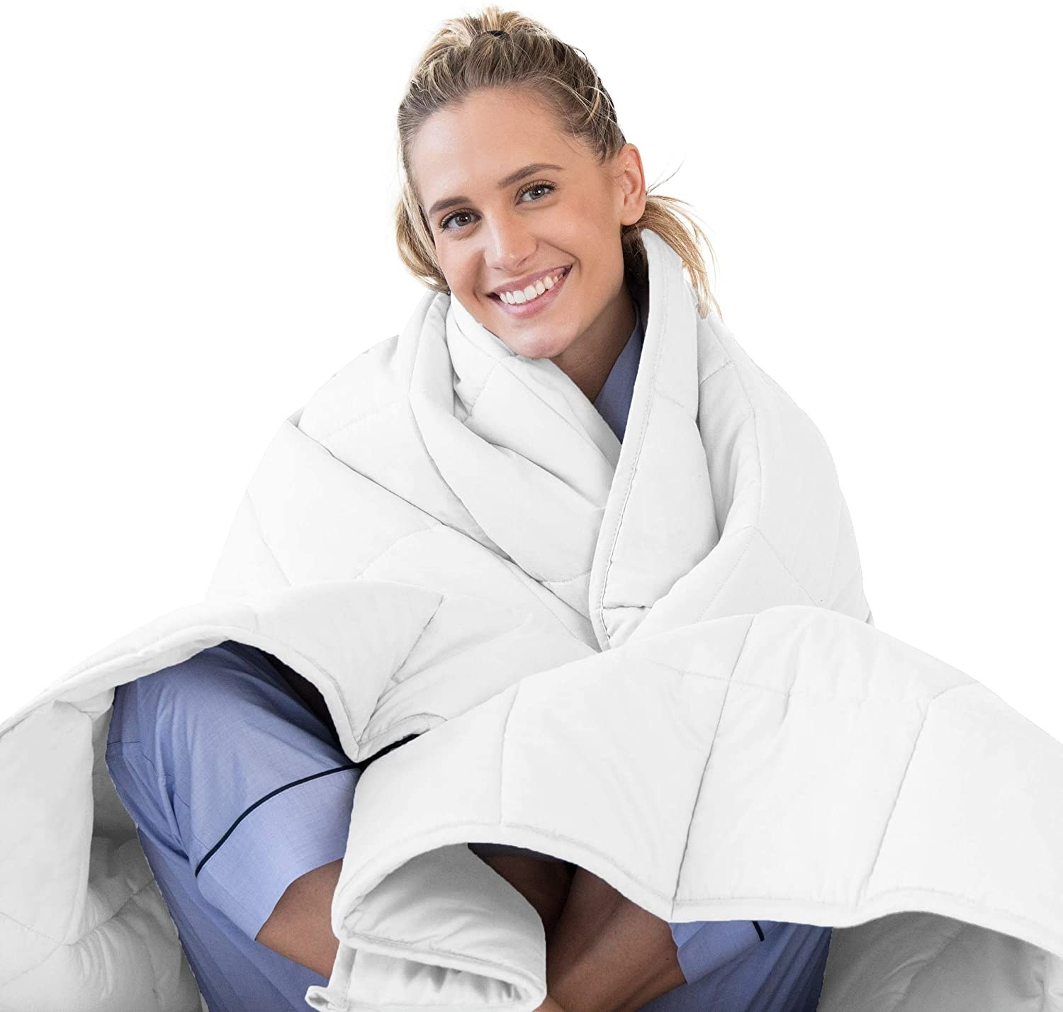 Model snuggled in a white weighted blanket