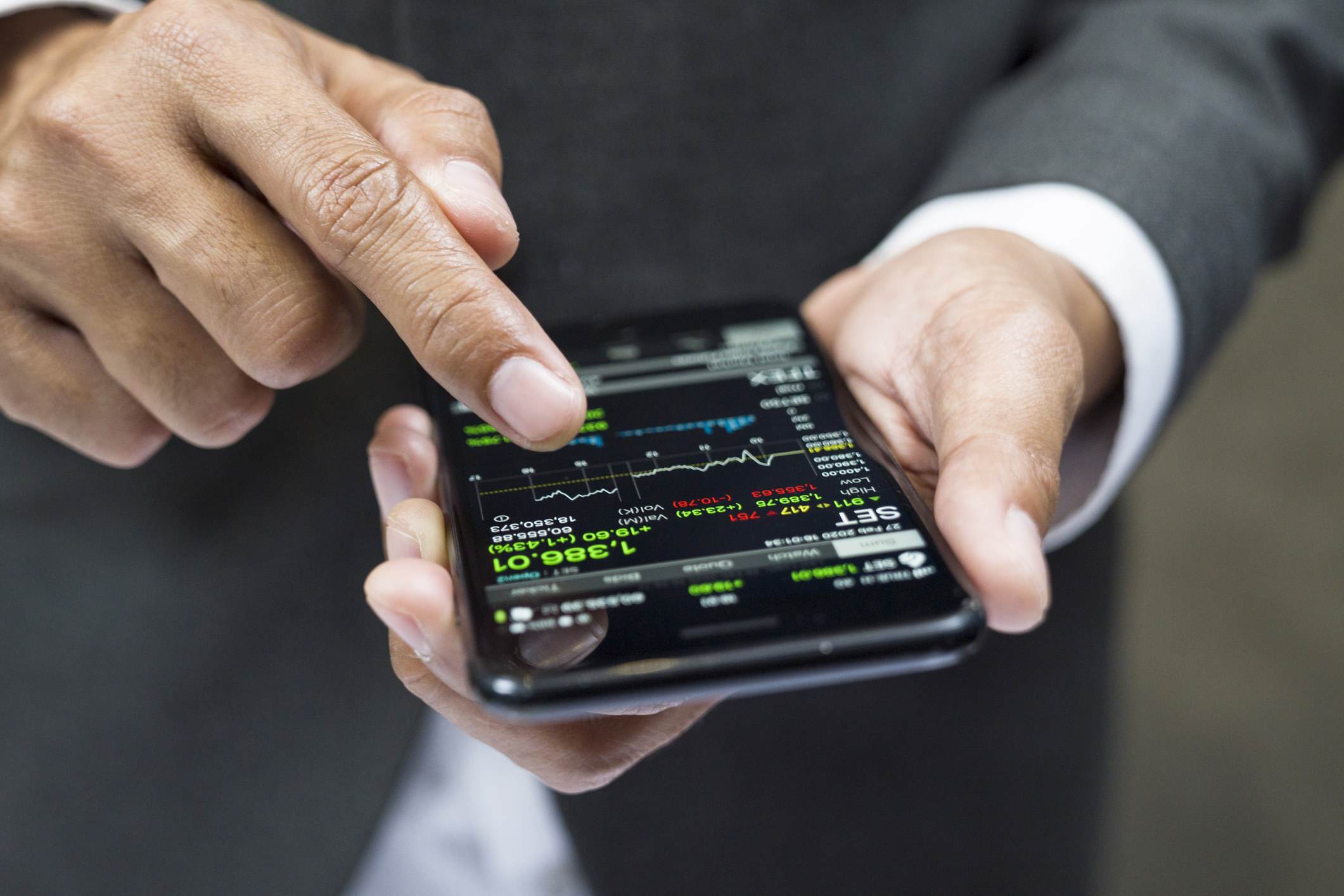 Person investing on a phone