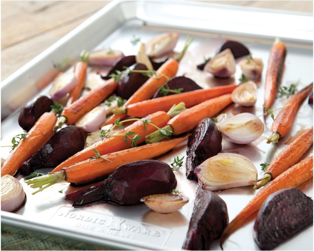 A baking sheet covered in roasted veggies