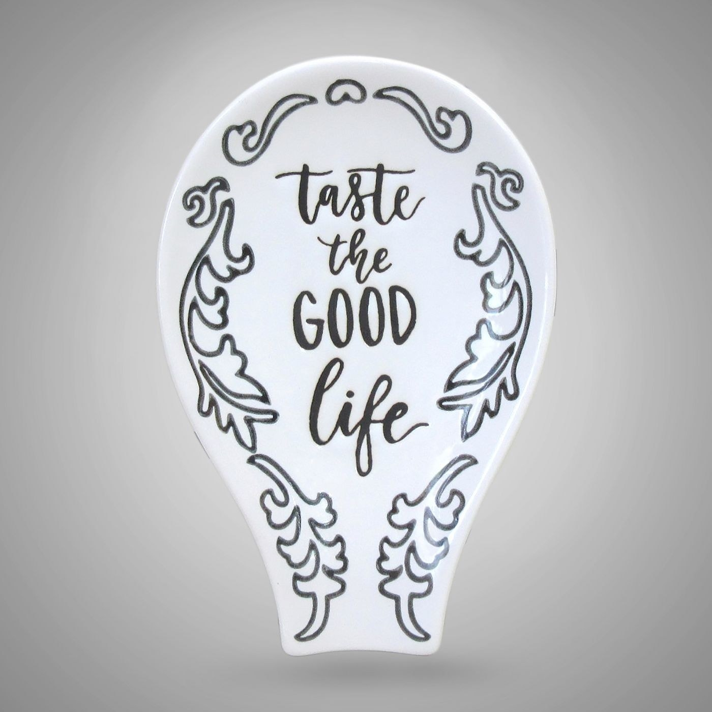 A black and white spoon rest