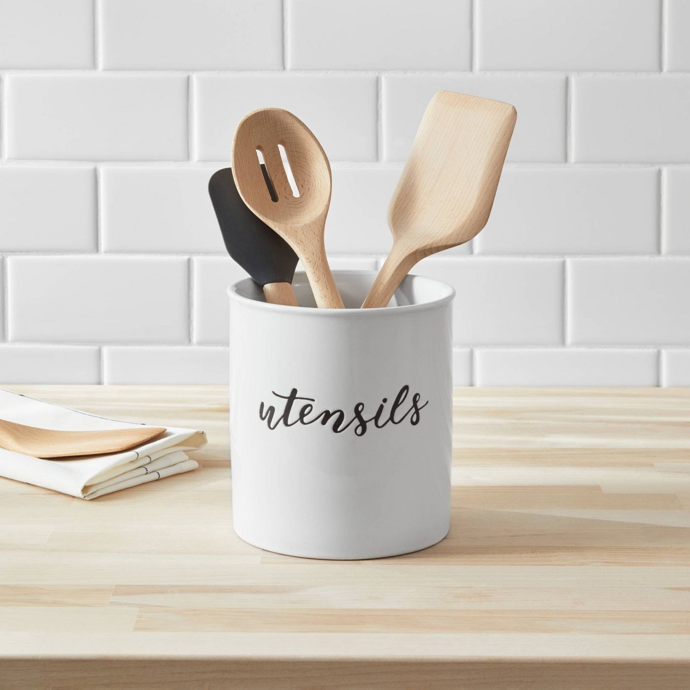 A black and white utensil cup