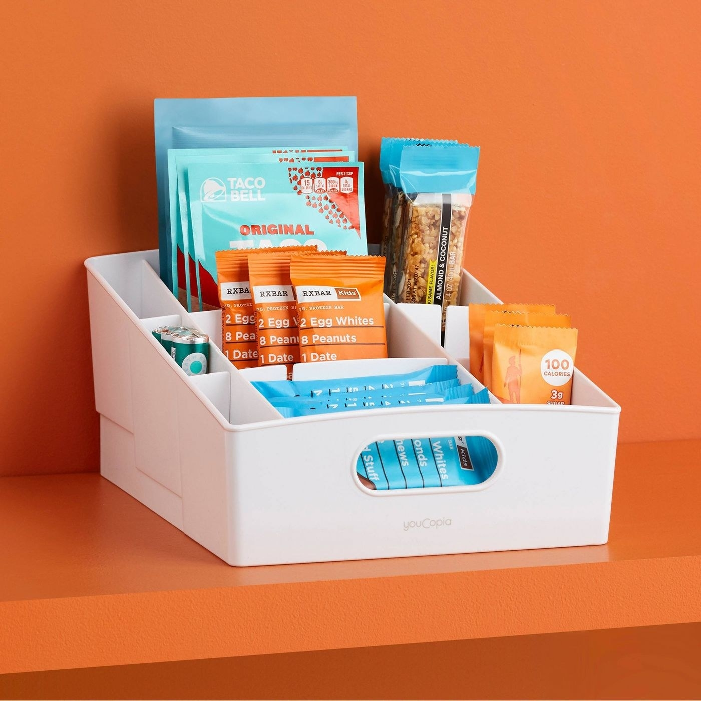 A snack sorter with items in it