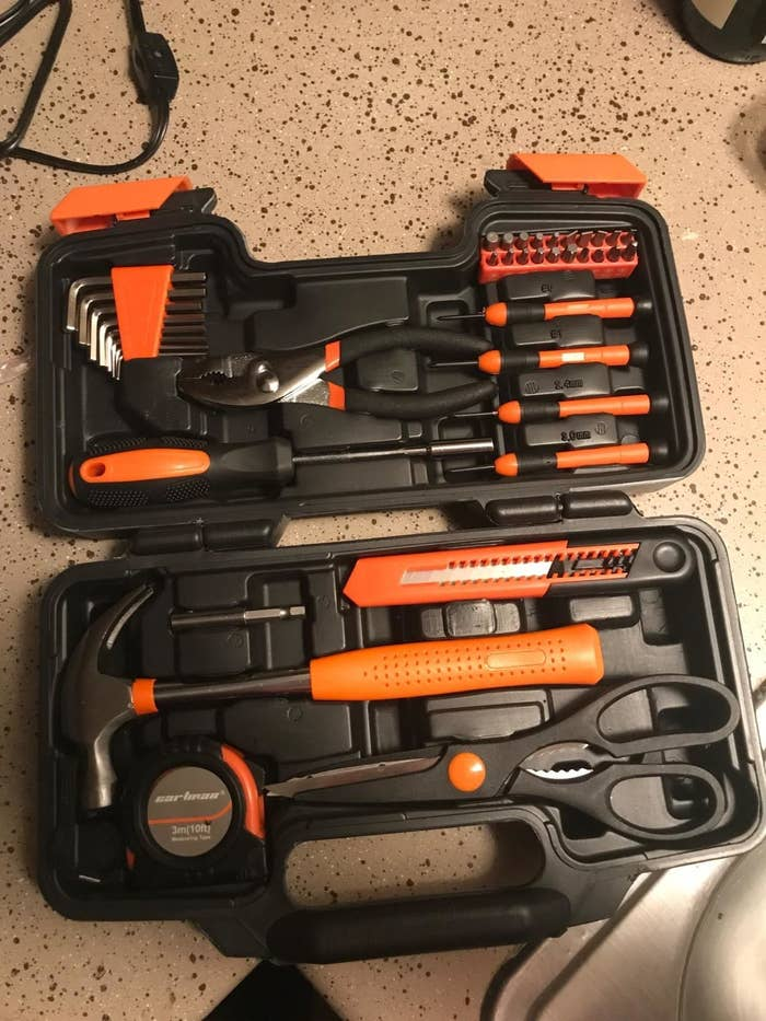 A reviewer photo showing the open case of the 39-piece toolkit filled with orange and black tools