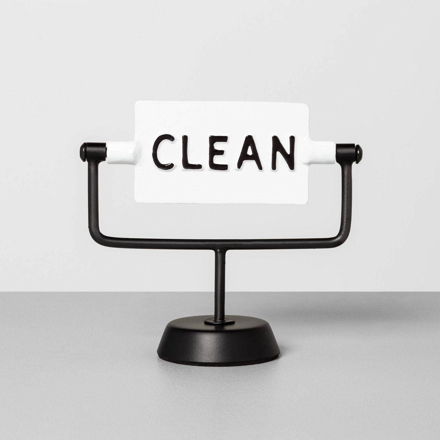 A black and white, clean/dirty sign