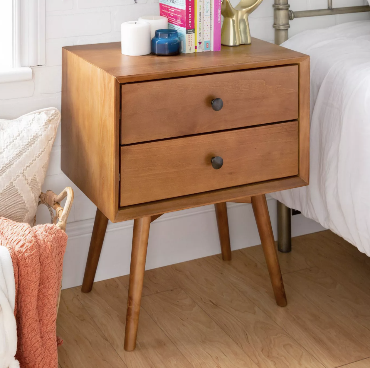 a mid-century modern two-drawer wooden end table