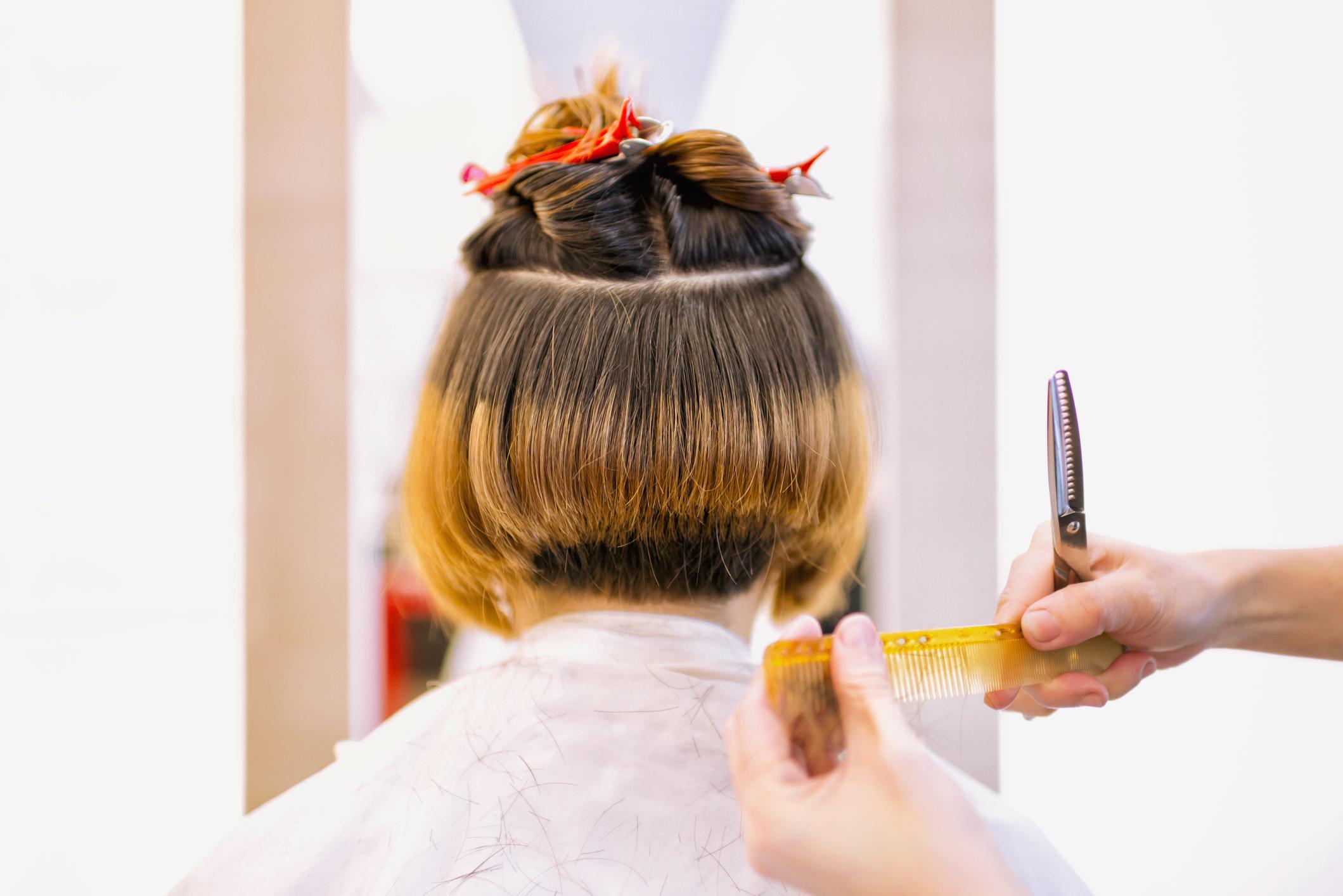 A woman receiving a haircut