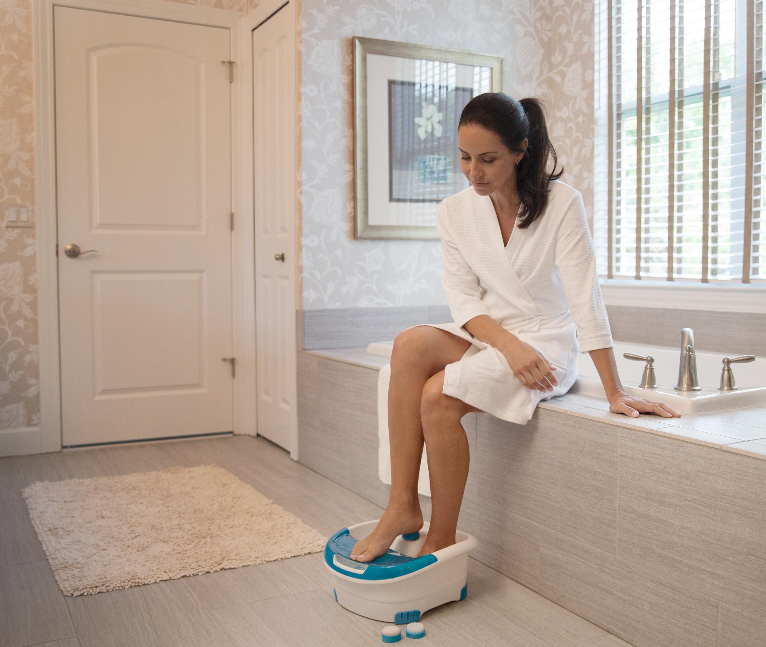 person using a pedicure footbath to soak their feet