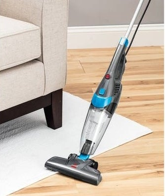 The vacuum being used on a rug