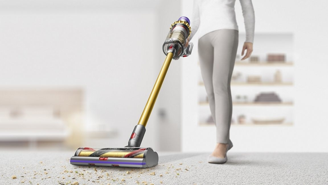 person pushing the dyson vacuum