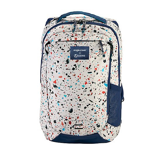 a white backpack with speckled colors all over it
