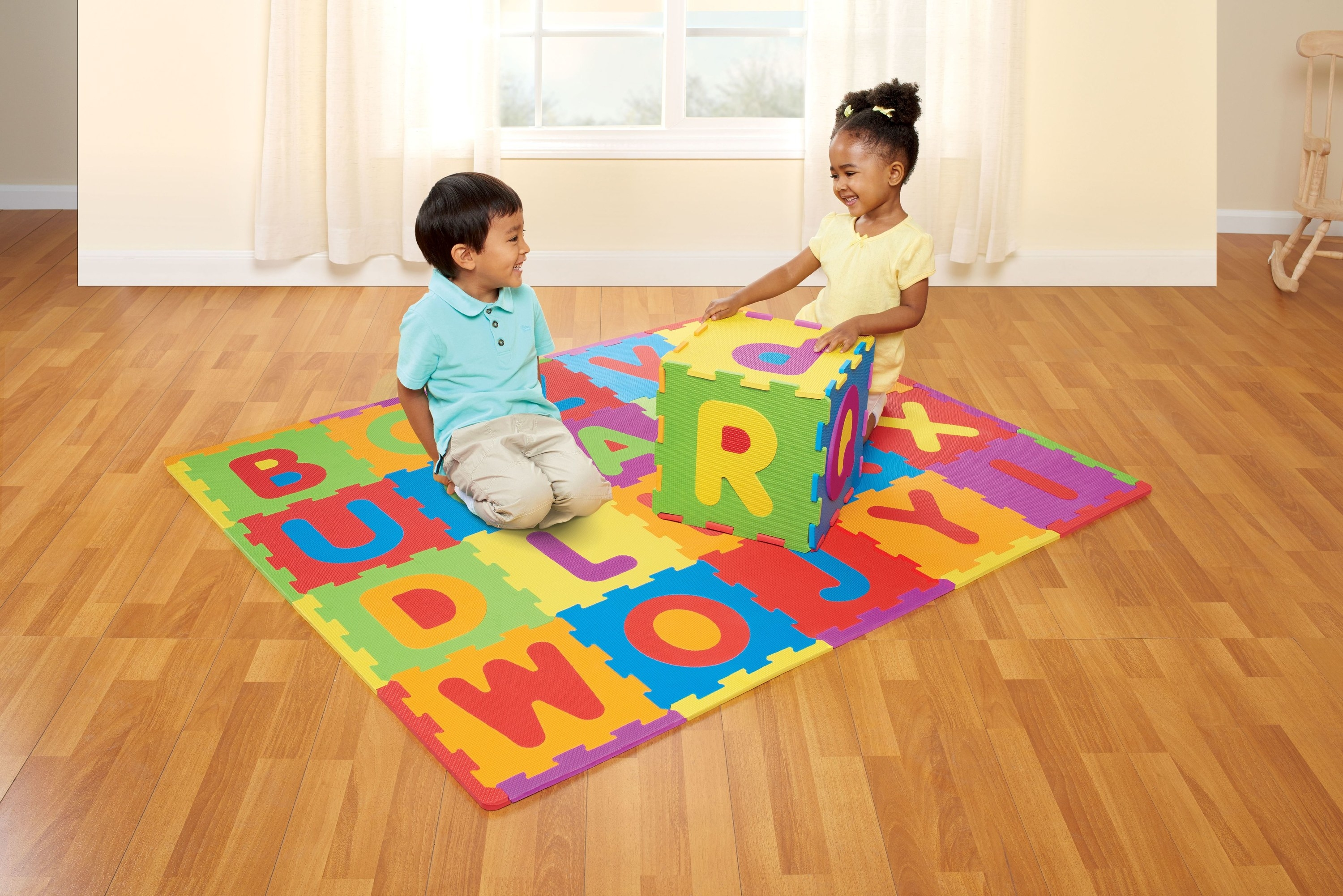 Two children on the brightly colored mat