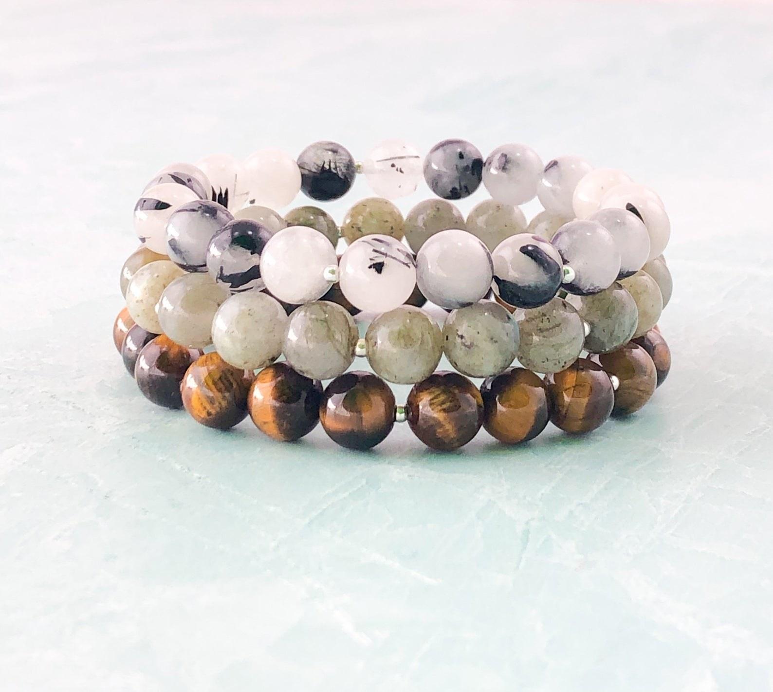 a stack of beaded bracelets