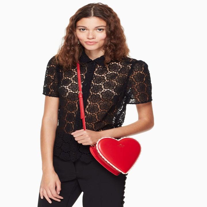 model wearing the heart5 crossbody