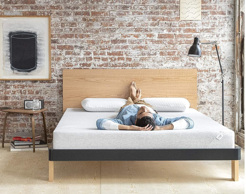 a model laying on a foam mattress