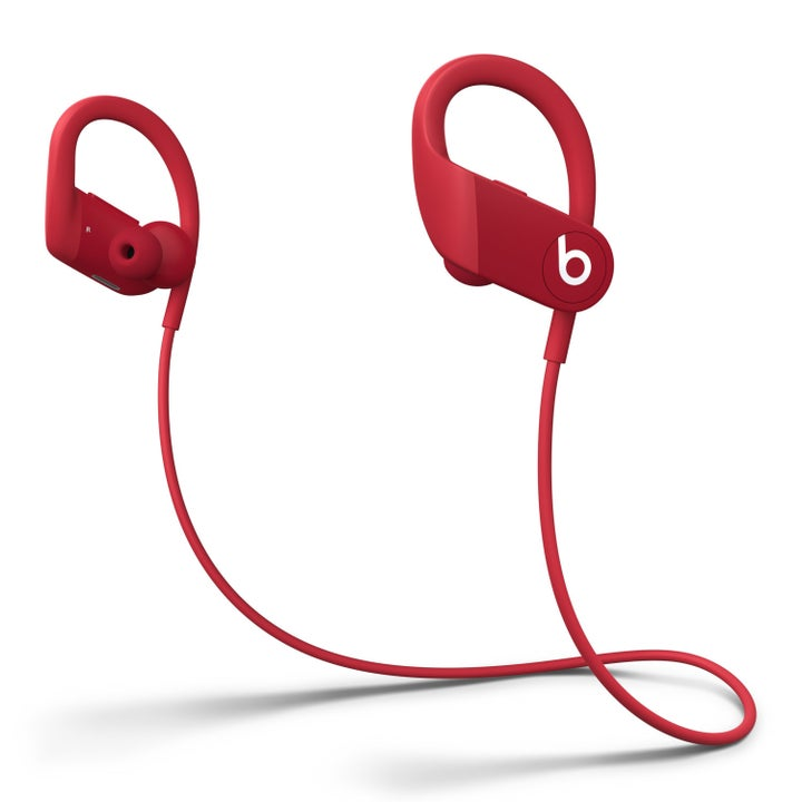red powerbeats headphones with a string to attach them to each other